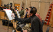 French horn player Steve Becknell makes a correction to his part