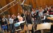 Marc Mann conducts the choir
