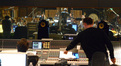 Scoring mixer Alan Meyerson and composer Henry Jackman watch conductor Nick Glennie-Smith and the Hollywood Studio Symphony perform on <i>G.I. Joe: Retaliation</i>