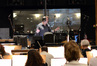 Conductor Gordon Goodwin speaks with the orchestra