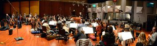 The Hollywood Studio Symphony records a cue with conductor and orchestrator Tom Calderaro