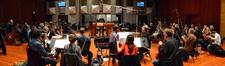 Composer Rolfe Kent conducts the orchestra on <i>Labor Day</i>