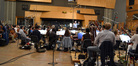 Nicholas Dodd conducts the orchestra