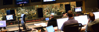 Scoring mixer Brad Haehnel, composer Andrew Lockington, ProTools recordist Eric Swanson, and ____ watch Nicholas Dodd and the Hollywood Studio Symphony perform on <i>Percy Jackson: Sea of Monsters</i>