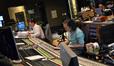 Composer Michael Giacchino and scoring mixer Joel Iwataki make notes to their scores