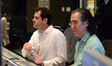 Composer Michael Giacchino and scoring mixer Joel Iwataki listen to a cue