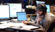 Assistant music editor Paul Apelgren reviews the score