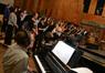Music librarian Marshall Bowen accompanies the choir