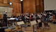 Tim Simonec conducts the choir