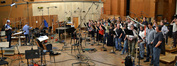 Conductor Tim and the choir prepare to record