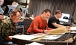 Music copyist Ross deRoche, composer Harald Kloser, and scoring mixer Alan Meyerson
