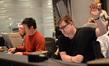 Composer Harald Kloser and scoring mixer Alan Meyerson listen to a cue