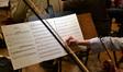 A violist edits a part