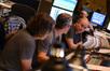 Scoring mixer John Kurlander (right) talks to additional music composer Buck Sanders (left) and composer Marco Beltrami (center)
