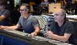 Composer Marco Beltrami and scoring mixer John Kurlander listen to a cue