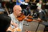 Marc Sazer tunes his violin