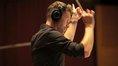 Composer Brian Tyler conducts his score to <i>Teenage Mutant Ninja Turtles</i>