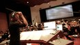 Composer Brian Tyler cues the cello section during an intense action sequence