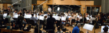 Conductor Nick Glennie-Smith and the orchestra perform on <i>Big Hero 6</i>