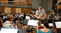 Composer Michael Giacchino and orchestrator/conductor Tim Simonec make edits to a cue