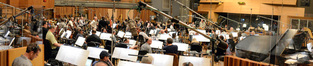 The Hollywood Studio Symphony performs on Michael Giacchino's <i>Dawn of the Planet of the Apes</i> under the baton of conductor/orchestrator Tim Simonec