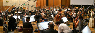 Conductor/orchestrator Tim Simonec and the orchestra