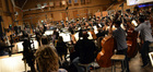 Composer Alexandre Desplat conducts a 108-piece orchestra on <i>Godzilla</i>