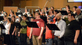 An 80-person choir performs on <i>Godzilla</i>