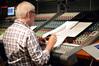 Universal Studios Japan Senior VP of Entertainment Mike Davis makes notes on a cue