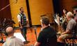 Composer Christopher Lennertz talks with the horn section