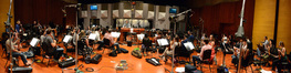 Composer and conductor Christopher Lennertz and the orchestra perform on <i>Horrible Bosses 2</i>