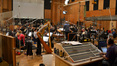 The orchestra tunes and the levels are set