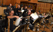 The brass change music for the next cue