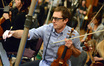Violist Neel Hammond makes a correction to his part