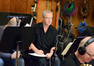 Trumpet player Jon Lewis makes a note in his part
