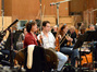 Concertmaster Belinda Broughton and the first violins wait patiently for the next take