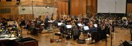 Conductor Pete Anthony and the orchestra prepare to record the next cue