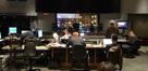 Stage recordist Adam Michalak, scoring mixer Richard Breen, orchestrator David Slonaker, music editor Chuck Martin, director Seth MacFarlane (standing), and booth reader Margaret Batjer