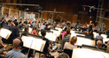 Composer and conductor Joel McNeely and the orchestra perform on <i>A Million Ways To Die In The West</i>