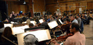 The view from the viola section as composer Joel McNeely conducts the orchestra