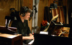Pianist Bryan Pezzone performs on a cue