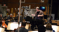 Composer Joel McNeely conducts the orchestra on <i>A Million Ways To Die In The West</i>