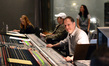 Scoring mixer Richard Breen poses for the camera as booth reader Margaret Batjer and director Seth MacFarlane listen to the score