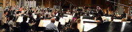 Composer and conductor Joel McNeely and the orchestra