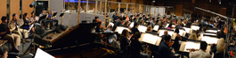 Composer Joel McNeely and the orchestra perform