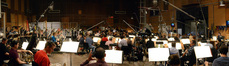 The view from the French horn section as conductor Tim Davies and the orchestra record