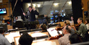 Tim Davies conducts the strings as the booth watches