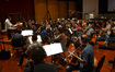Composer and conductor Christopher Lennertz with the orchestra