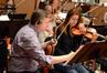 Violinist Mark Robertson makes edits to his part