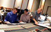 Orchestrator Andrew Kinney, score coordinator Drew Silverstein, and scoring mixer Jeff Vaughn look over a cue